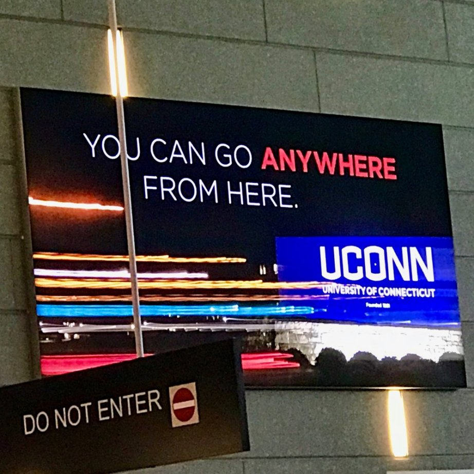 A UConn advertisement prominently displayed near airport security at Bradley International Airport.  Donald Pendagast.